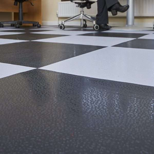 Smoothflex black and grey floor tiles used in an warehouse office environment PVC interlocking mats